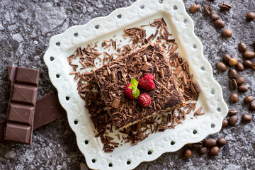 Tiramisu Cake with Grated Chocolate, Raspberry and Mint. Perfect Dessert.