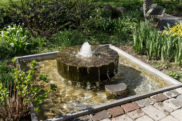Small angular fountain with water in the park Wall mural