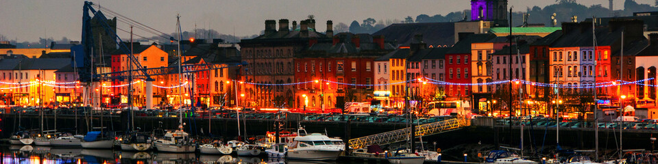 Panoramic view of a cityscape at night with illumination in Waterford, Ireland