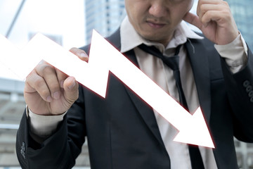 Businessman serious with stock fall