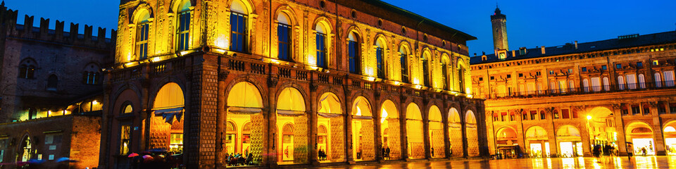 King Enzo palace at the main square of Bologna, Italy. Famous landmark at sunset at night.