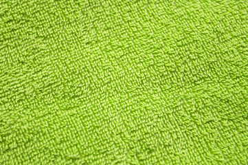 Lime green towel background, texture of cotton fibers of bath towel close up