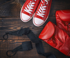 red leather boxing gloves and textile sneakers