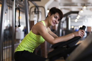 woman in the gym on a stationary bike