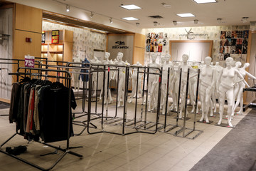 Mannequins are displayed at a fashion shop announcing a closing sale before it shuts down in Indianapolis