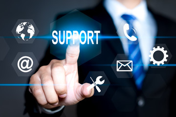 Businessman pressing button on virtual screens Technical support. Customer help. Business and technology concept