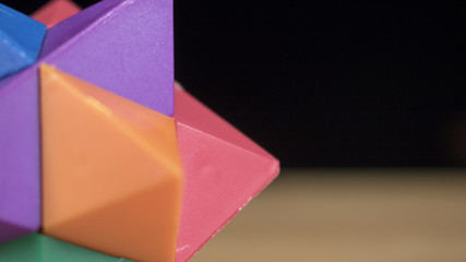 Close up of a geometric toy that is colorful