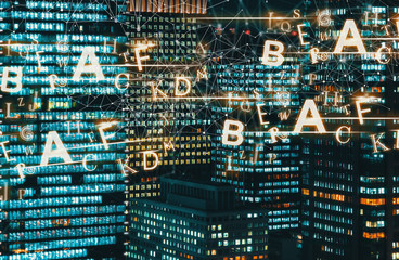 Alphabets with skyscrapers illuminated at night in Tokyo, Japan