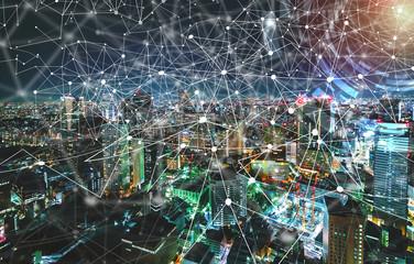 Digital Tech Circle with aerial view of Tokyo, Japan at night