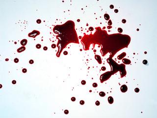 Fake red blood splatter on white background