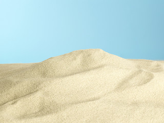 Sand pile on blue background