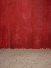 Red wall and dirt floor