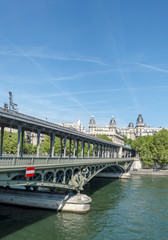 Parisian metro train on the Bir-Hakeim bridge over the Seine, vertical