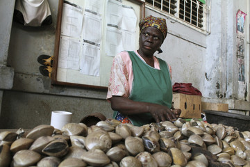 A woman sells clams in the main market of Maputo
