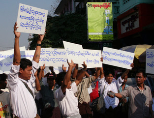 Activists hold a protest requesting better social and economic conditions for Myanmar's people in Yangon