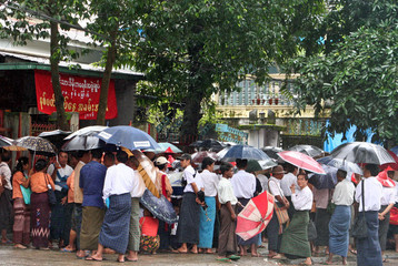 Members of the National League for Democracy party and their supporters gather in Yangon