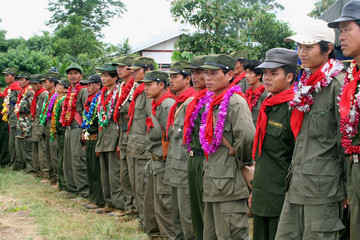Members of the Shan State Army (South) brigade who surrendered to the government attend a ceremony in Laihka