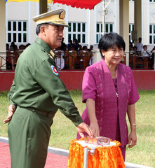 Myanmar Home Minister Maung Oo and Dean of the Diplomatic Corps Gomez press a button to set on fire drugs in Yangon