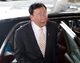 Philippine Foreign Secretary Alberto Romulo arrives at a hotel in Yangon