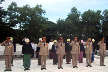 Myanmar's military officers attend a ceremony marking Matyrs' Day at the Matyrs' Mausoleum in Yangon.