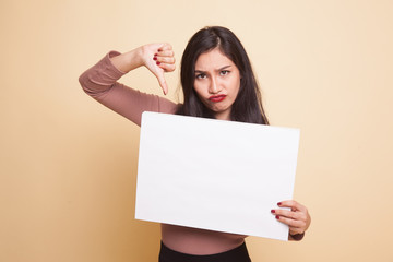 Young Asian woman show thumbs down with white blank sign.
