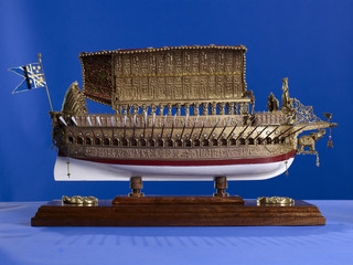 Historic ship model on blue background