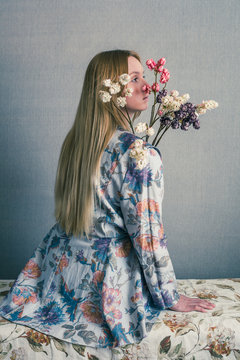 woman with flowers and vintage clothing