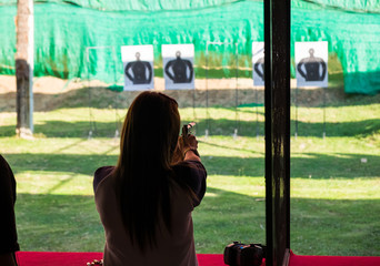 Woman practice shooting pistol