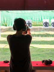 Man practice shooting pistol