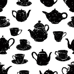 pattern of the silhouettes of teacups and teapots