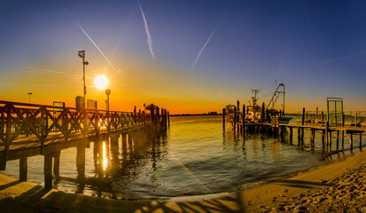 Vintage wooden pier at beach sunset, Lido di Jesolo, Venice, Italy
