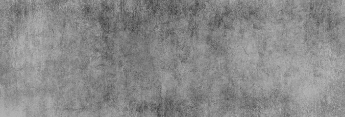 Obraz Textur einer dunkelgrauen Betonwand in XXL-Größe als Hintergrund, auf die ein wenig Licht fällt - fototapety do salonu