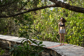 Beautiful mixed race woman photo shoot in mangrove forest.