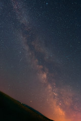 The Milky Way and shooting stars as seen from the Odenwald in Germany.