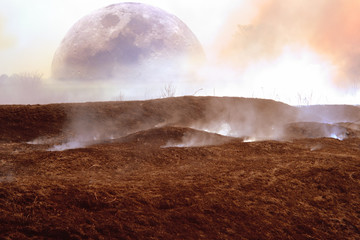 fantasy of the surface of another planet with charred and charred earth and smoke with a view of the moon and a lonely tree