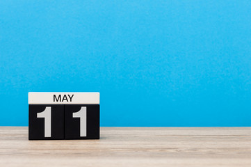 May 11th. Day 11 of month, calendar on blue background. Spring time, empty space for text