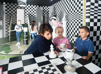 friends play in quest room in chess style