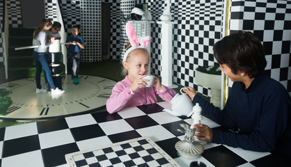 young players play in chess  quest room