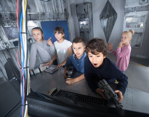 children play in the quest room of a inscrutable bunker