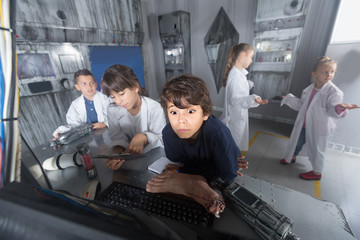 Children playing in bunker quest room