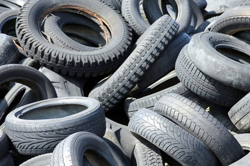Detail of a scrap tire dump with different types of tires