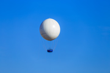 white balloon in the blue sky