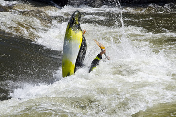 Kayaker Popping Out Of Whitewater Rapid