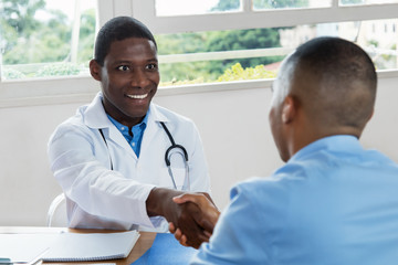 African american doctor welcoming patient