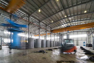 Working process for the manufacture of concrete pipes in the factory warehouse. Industry manufacturing concept