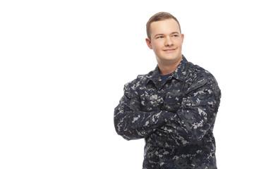Young man in navy uniform looking away