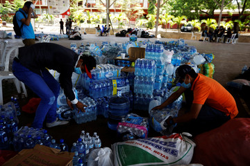 University students store bottled water in a gym in preparation for protests in Managua