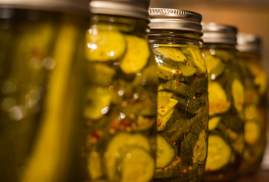 homestead canning pickles, peppers and spaghetti sauce.