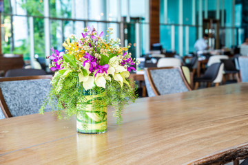 flowers in vase on dinning table