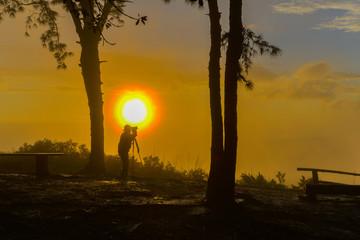 Un-identified photographer shooting photo of beautiful sunrise view